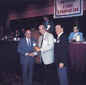 Bob Bartlett, far right, presents an award during a National Stone Association convention in the 1980s.