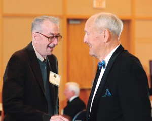 Paul Detwiler Jr., left, visits with Bernie Grove during a past Hall of Fame induction ceremony.
